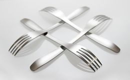 Fork cross. Reflected forks on a white background stock image