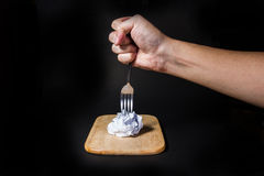 Fork on crumpled paper on black background.  Stock Photo