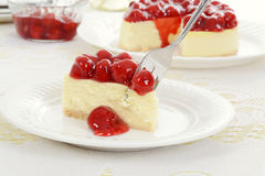 Fork cutting cherry cheesecake Royalty Free Stock Photo