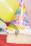 Fork Cutting Vanilla Lemon Birthday Cake Stock Photo
