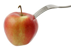 Fork dig into apple Stock Photo