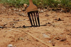 Fork in dirt. A fork stuck in dirt Stock Images