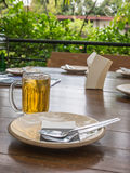Fork and dish with beer. On dining table Royalty Free Stock Image