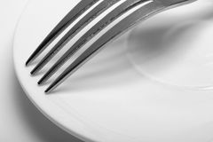 A fork on a Dish. close-up on white background Royalty Free Stock Photo