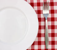 Fork and empty plate Royalty Free Stock Image