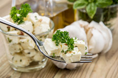 Fork with Feta Cheese on wood Stock Image