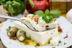 Fork with Feta and portion in the back Royalty Free Stock Image