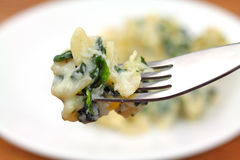 Fork Filled With Ricotta Cheese Spinach Pasta Royalty Free Stock Photos