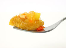 Fork filled with sweet and sour chicken Stock Image