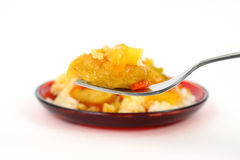 Fork filled with sweet and sour chicken Royalty Free Stock Photo