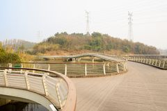 Fork footbridge with railings and planked roadway in sunny winter afternoon. Fork footbridge with guardrail and planked roadway in sunny winter afternoon,Chengdu stock images
