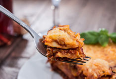 Fork with fresh made Lasagne Stock Images