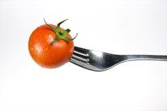 Fork with Fresh Tomato. On white background Stock Photos