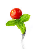 Fork with fresh tomato and basil Stock Image