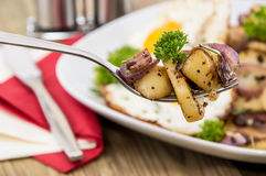 Fork with fried Potatoes Royalty Free Stock Images