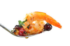 Fork with a fried shrimp and berries isolated Stock Photo
