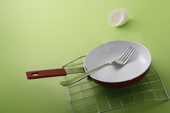 Fork in frying pan Stock Photo