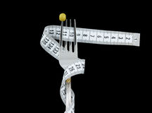 Fork with green peas and measuring tape isolated Stock Images