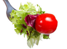 Fork with greens and tomato Stock Photos