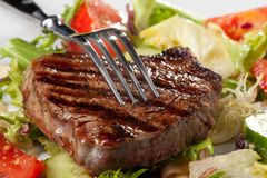 Fork on a grilled steak Stock Photography