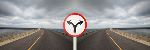 Fork junction sign with crossroads spliting in two way. Fork junction traffic sign with crossroads spliting in two way stock images