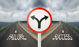 fork junction traffic sign with crossroads spliting in two ways, choose Failure or Success road stock photos