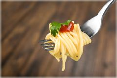 Fork with just spaghetti around it on backgrouund. Fork just spaghetti background isolated closeup food stock images