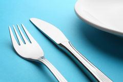 Fork and kinfe and plate Stock Photos