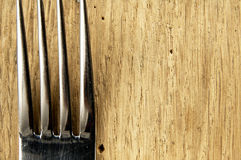 Fork on the kitchen table. Stock Photos