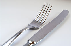 Fork and knife. On white Royalty Free Stock Image