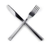 Fork and knife. Crossed fork and knife isolated on white royalty free stock photo