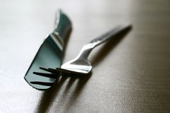 Fork and knife. Isolated on table top, shallow DOF royalty free stock photos