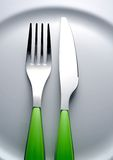 Fork knife. Fork and knife on white plate Stock Image