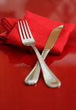Fork and Knife. An elegant holiday table setting in red and white Stock Photo