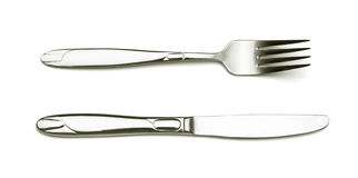 Fork and knife. Silver fork and knife on white background stock images