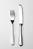 Fork and knife. Silver fork and knife on gray background royalty free stock photo