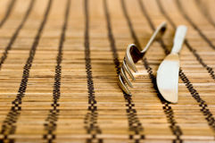 Fork and knife. Utensil on the bamboo napkin royalty free stock photos