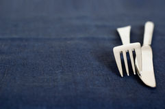 Fork and knife. Utensil on the blue flax napkin stock images