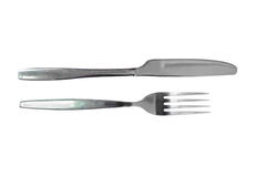 Fork and knife on a black background. Silver table cutlery or flatware comprising of fork, knife a isolated on a black background Royalty Free Stock Photos