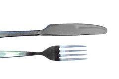 Fork and knife on a black background. Silver table cutlery or flatware comprising of fork, knife a isolated on a black background Stock Photography