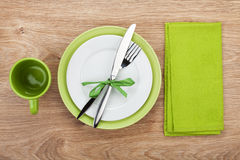 Fork with knife, blank plates and napkin. Fork with knife, blank plates, empty cup and napkin. On wooden table background Stock Photo