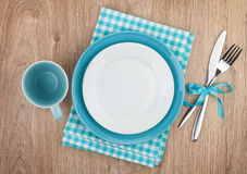 Fork with knife, blank plates and napkin Stock Photos