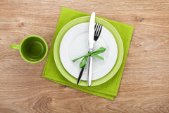 Fork with knife, blank plates and napkin Royalty Free Stock Photography