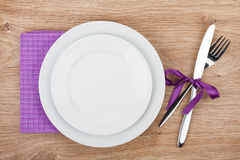 Fork with knife, blank plates and napkin Stock Photography