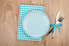 Fork with knife, blank plates and napkin Royalty Free Stock Images