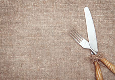 Fork and knife on the burlap Stock Photos