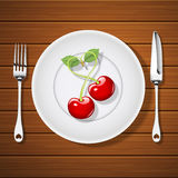 Fork with knife and cherries in heart shape on plate Stock Photos