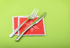 Fork and knife in a christmas napkin Stock Photo