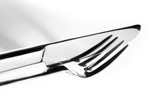 Fork and knife, close up Stock Images