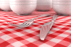 Fork and Knife closeup on a red table cloth. With dashware behind Vector Illustration